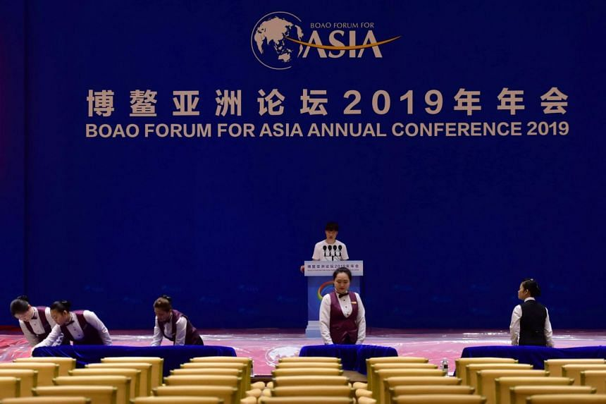 Staff members make preparations ahead of the Boao Forum at a conference hall in Qionghai, Hainan province, China, on March 23, 2019.