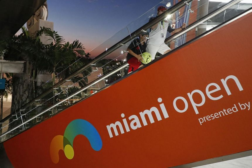 Fans take the escalator to the upper level of the stadium court at the Miami Open tennis tournament in Miami, Florida, USA, on March 24, 2019.