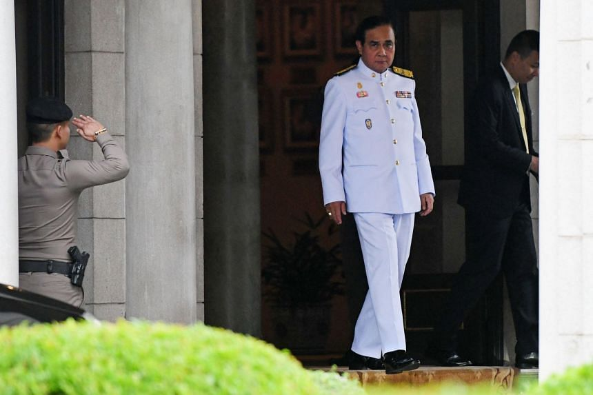 Thailand's Prime Minister Prayut Chan-o-cha leaving Government House in Bangkok yesterday. Official results of the election are expected only in May, as the Election Commission investigates alleged irregularities, such as claims of some three million