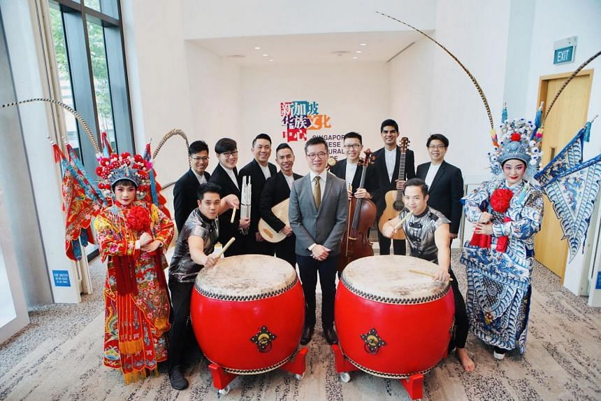 Singapore Chinese Cultural Centre (SCCC) chief executive Low Sze Wee (in grey) with members of the three performing arts groups that will be moving into the SCCC building in April.