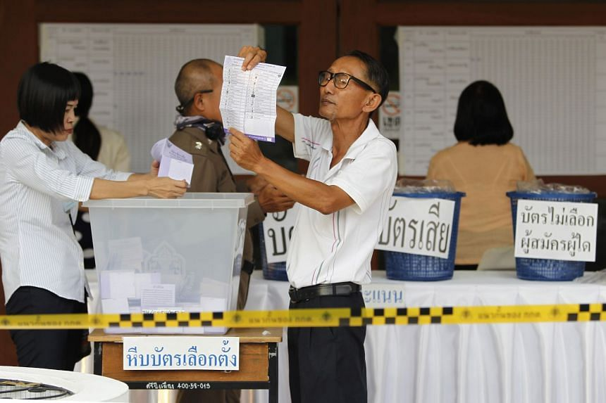 Thai electoral officials counting ballots at a polling station in a temple in Chiang Mai, northern Thailand, on March 24, 2019.