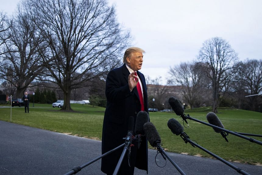 US President Donald Trump (above) speaking to reporters outside the White House in Washington on Sunday. He said that Special Counsel Robert Mueller's 22-month inquiry into Russian interference was ''an illegal takedown that failed''.