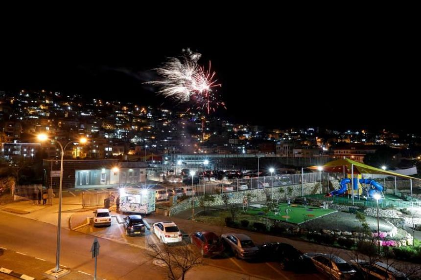 Fireworks explode over the Druze city of Majdal Shams, in the Israeli-annexed Golan Heights, facing the Syrian border, on January 1, 2019. Indonesia has firmly rejected the Trump administration's recent decision to recognise the area as part of Israe