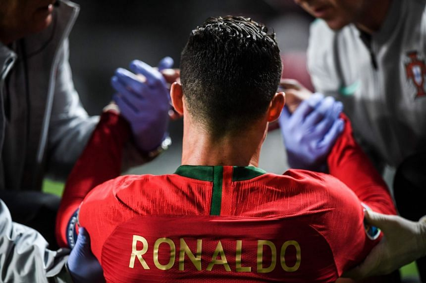Ronaldo is attended by doctors during the match.
