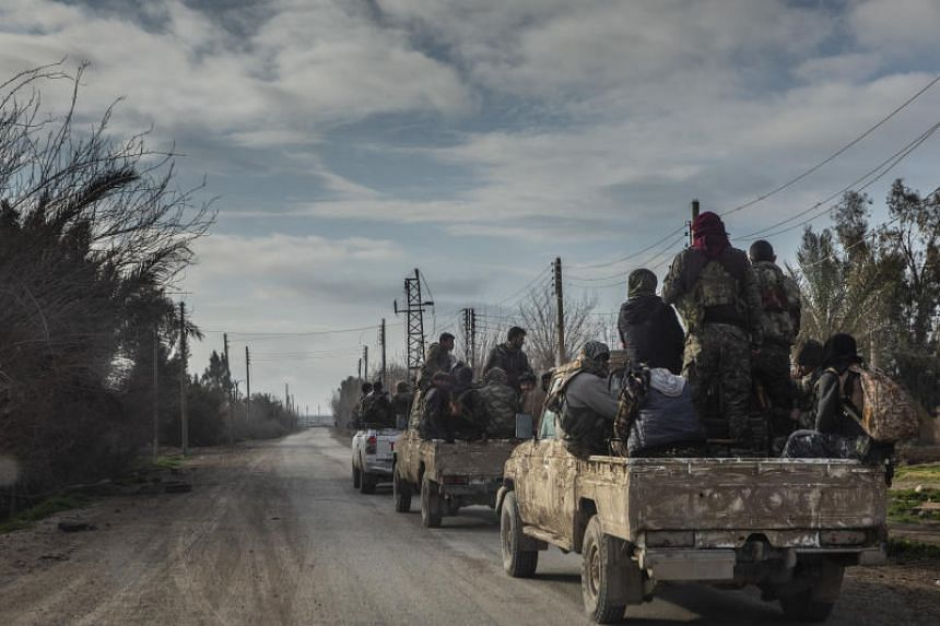 US-backed Syrian Democratic Forces speed toward the frontline in the fight for the last Islamic State territory in Baghouz, Syria on Feb 11, 2019.