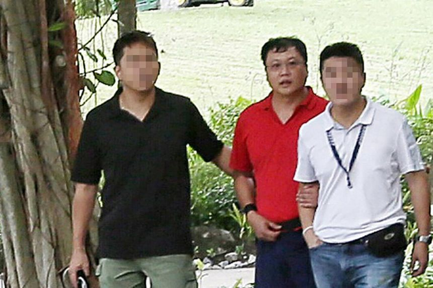 Leslie Khoo Kwee Hock (centre) is facing a possible death sentence for murdering engineer Cui Yajie in his car along a quiet road near Gardens by the Bay on July 12, 2016. He later burnt her body at Lim Chu Kang Lane 8.