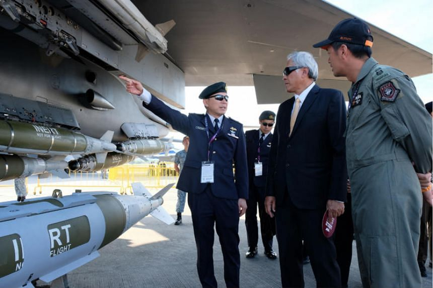 Defence Minister Ng Eng Hen being hosted by Chief of Air Force Brigadier-General Kelvin Khong and RSAF Detachment Commander Lieutenant-Colonel Shewan Goh at the F-15SG static display.