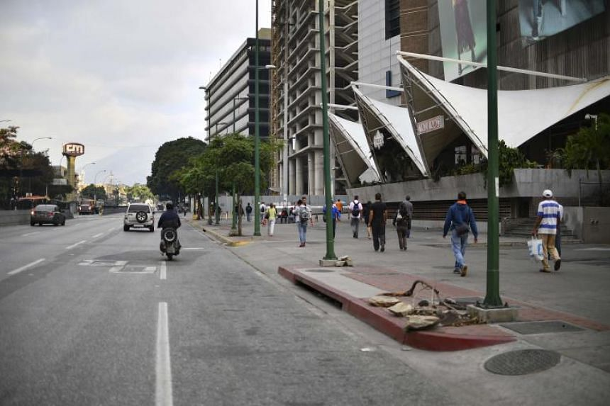 The outage shuttered businesses, plunged the city's main airport into darkness and left commuters stranded in Caracas.