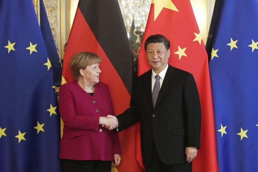 Chinese President Xi Jinping (right) and German Chancellor Angela Merkel (left) shake hands ahead of a bilateral meeting at the Hotel de Marigny residence in Paris, France on March 26, 2019.