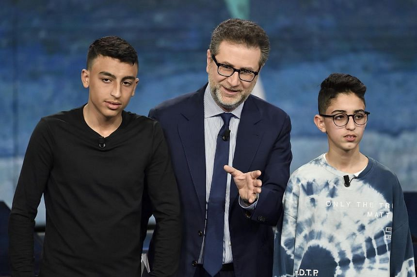 Ramy Shehata (left) appearing on a TV talk show with TV host Fabio Fazio (centre) and Adam El Hamami.