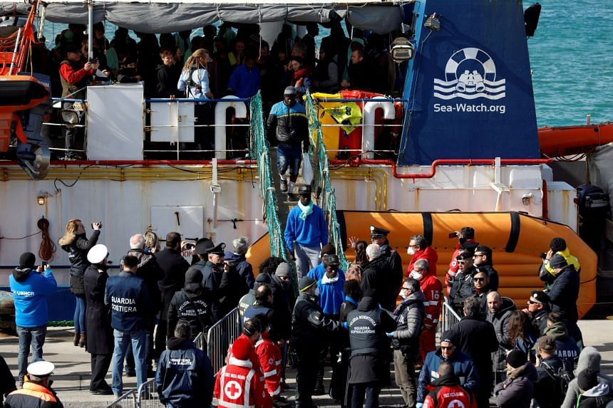 Migrants disembark from rescue ship Sea-Watch 3 as they arrive at the port of Catania, Italy, Jan 31, 2019.