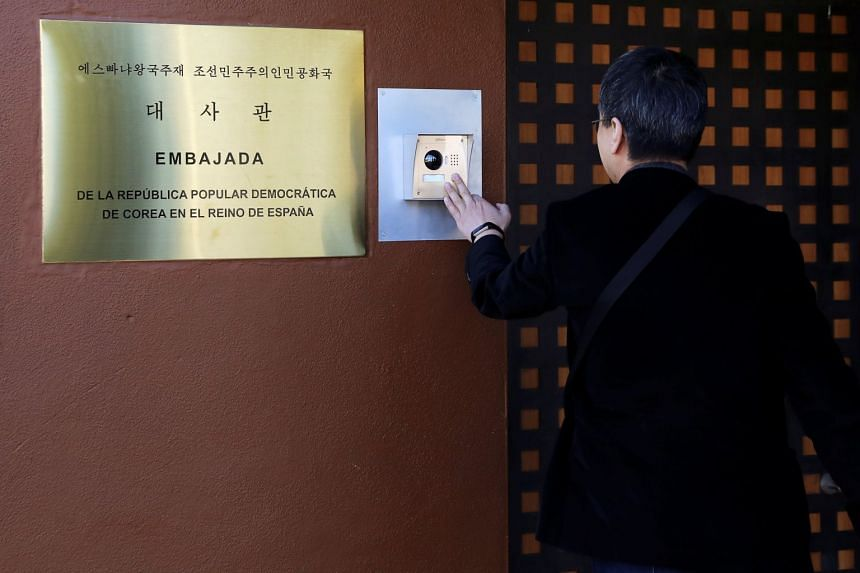 A journalist from South Korea rings an intercom of North Korea's embassy in Madrid.