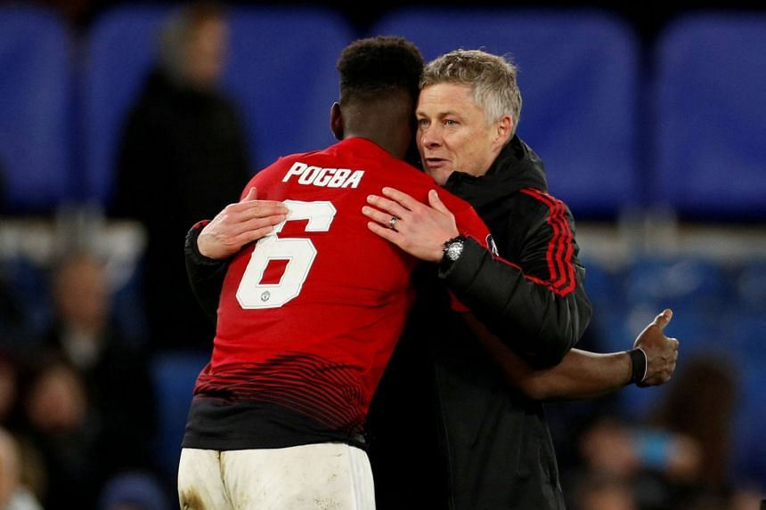 Solskjaer embraces Paul Pogba at the end of an FA Cup match against Chelsea.