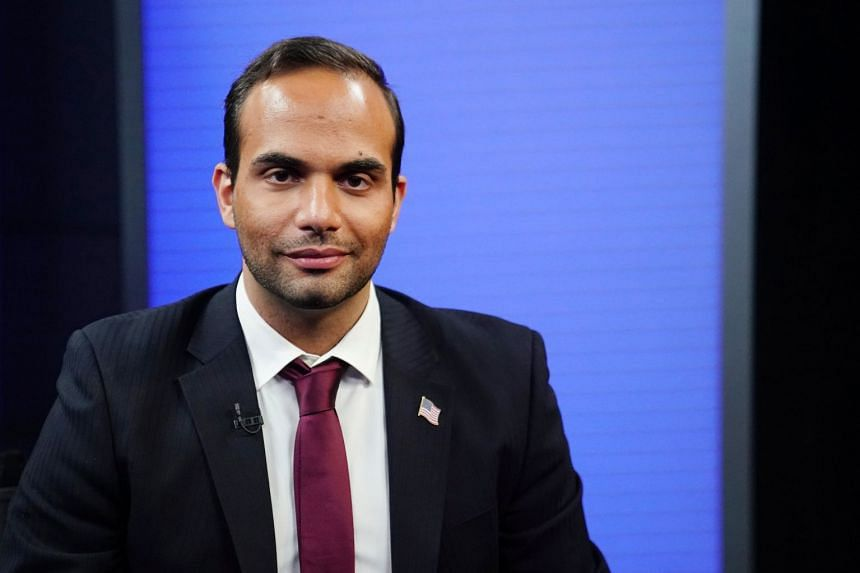 Papadopoulos poses for a photo before a TV interview in New York, March 26, 2019.