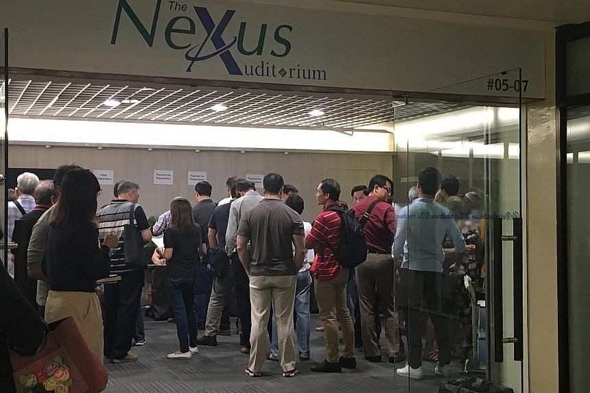 """A meeting organised by the Securities Investors Association Singapore (Sias) for Hyflux perpetual securities and preference shareholders last month. Investors facing huge losses want to know how the purchase price of """"zero dollars"""" that national wate"""