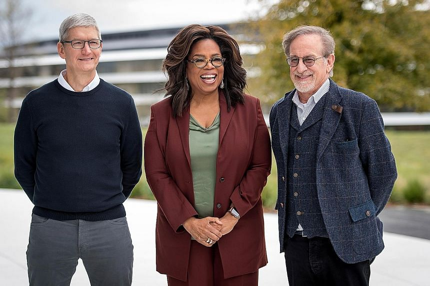 (From left) Apple chief executive Tim Cook, media mogul Oprah Winfrey and film-maker Steven Spielberg after the launch event in Cupertino, California, on Monday. Actors Jason Momoa and Alfre Woodard at the Apple TV+ launch. Hollywood stars (from left