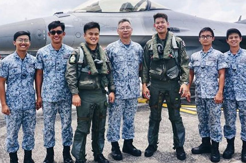 The two pilots - Major Jireh Ang and Captain Jonathan Ow Hsien-Kyn (third and fifth from left) - who flew the fighter jets scrambled yesterday, with their RSAF 143 Squadron colleagues (from left) Third Sergeant Melvin Chan Zhong Jun, Military Expert
