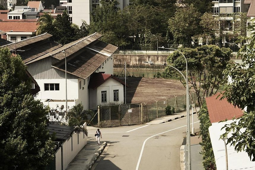 The small building housing the pre-World War II grave of a Muslim woman named Syarifah Zainah Alhabshi. The building is partially embedded in the wall of a warehouse at 49 Moonstone Lane, near Kallang River. The initial plan was to exhume the grave a