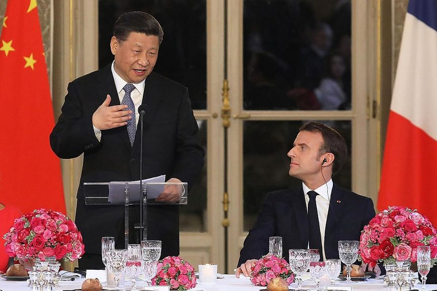 Chinese President Xi Jinping making a speech as French President Emmanuel Macron looks on during a state dinner at the Elysee Palace in Parison Monday. China has placed a $47 billion order with the European planemaker Airbus.
