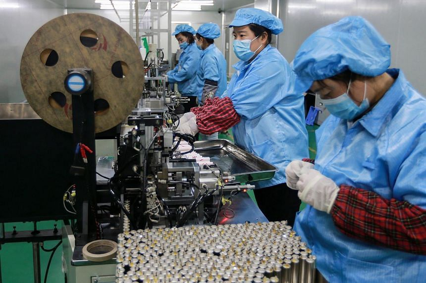 Employees working at a battery factory in Huaibei in China's eastern Anhui province.