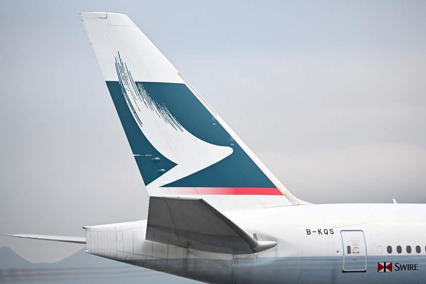 The Cathay Pacific logo seen on the tail of a passenger plane as it prepares to take off from Hong Kong's international airport, on March 13, 2019.
