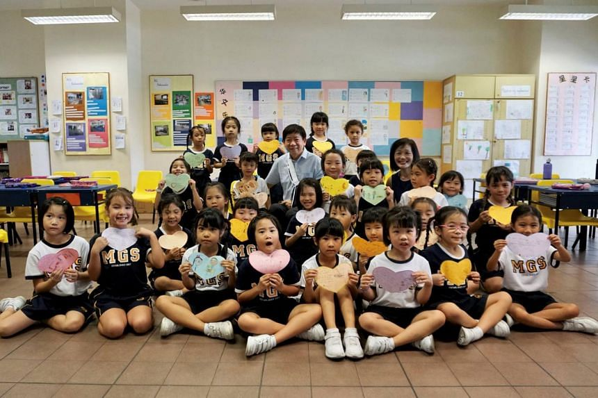 """Transport Minister Khaw Boon Wan paid a surprise visit to Methodist Girls' School to thank the pupils and told them about his """"nasty fall""""."""
