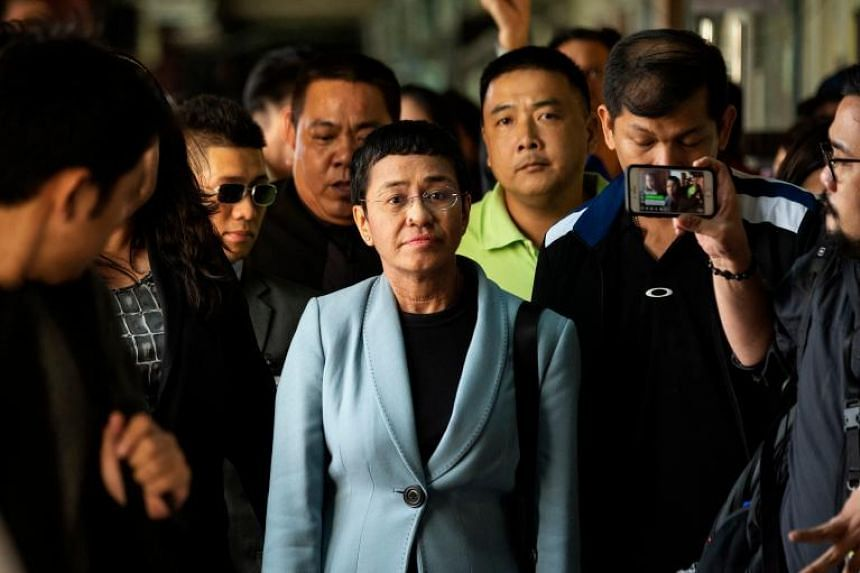 Philippine journalist Maria Ressa (centre) arrives at a regional trial court in Manila to post bail on Feb 14, 2019. Philippine authorities said on March 27 that they have filed more criminal charges against her.