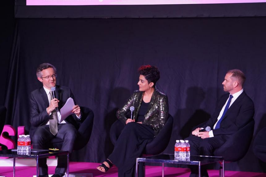 (From left) Professor Simon Chesterman, dean of NUS' law faculty, Saadia Muzaffar, founder of TechGirls Canada and entrepreneur and Anthony Burke, professor of architecture at the University of Technology Sydney during a panel discussion at the Inter