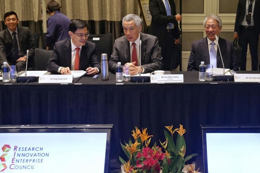 (From left) Finance Minister Heng Swee Keat, Prime Minister Lee Hsien Loong and Deputy Prime Minister Teo Chee Hean at the 11th Research, Innovation and Enterprise Council meeting on March 27, 2019.