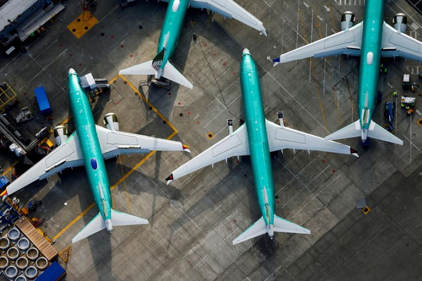 Boeing 737 Max airplanes parked on the tarmac at the Boeing Factory in Renton, Washington on March 21, 2019.