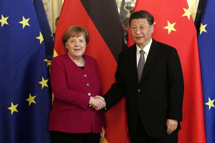 Chinese President Xi Jinping (right) and German Chancellor Angela Merkel shake hands ahead of a bilateral meeting at the Hotel de Marigny residence in Paris, France on March 26, 2019.