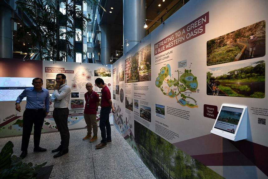 Visitors viewing the exhibition on the Draft Master Plan 2019 at The URA Centre on March 27, 2019.