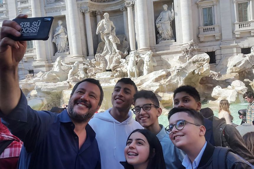Matteo Salvini takes a selfie with five children who helped to save other children during the attack.