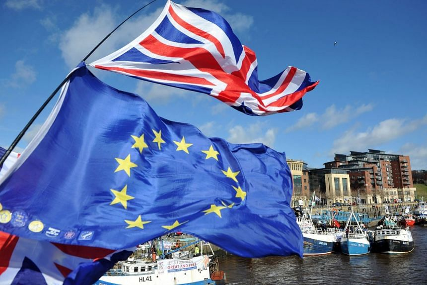 Anti-Brexit activists fly EU flags as fishing boats take part in a demonstration on the River Tyne in Newcastle, northeast England, on March 15, 2019