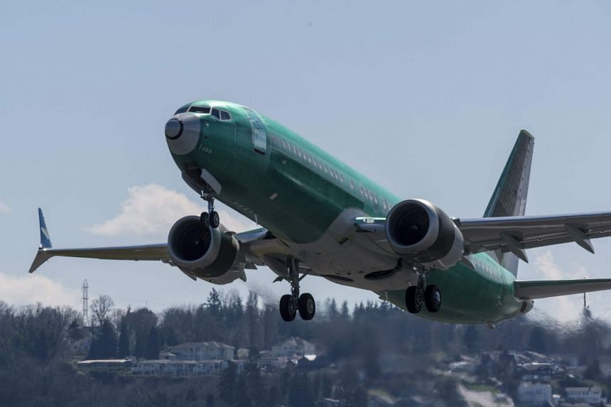A Boeing 737 Max 8 airliner takes off from Renton Municipal Airport near the company's factory, on March 22 in Renton, Washington.