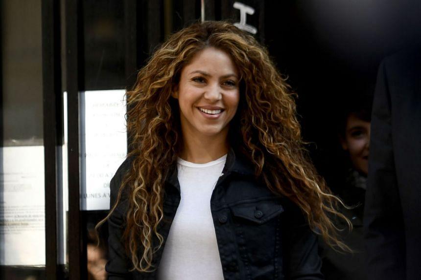 Colombian singer Shakira leaves the court in Madrid.