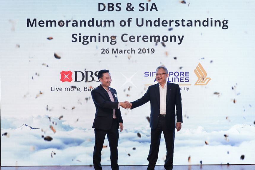 DBS Singapore country manager Shee Tse Koon (left) and SIA executive vice-president (commercial) Mak Swee Wah at the MOU signing yesterday. The two companies will launch flight booking and merchandising capabilities on DBS' platforms and a DBS-SIA Re
