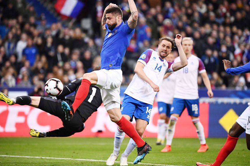 France's Olivier Giroud scoring against Iceland during the 4-0 win in their Euro 2020 qualifying match on Monday. The goal moved him to third place on the list of France's all-time top scorers on 35 goals, one ahead of David Trezeguet. Giroud now tra