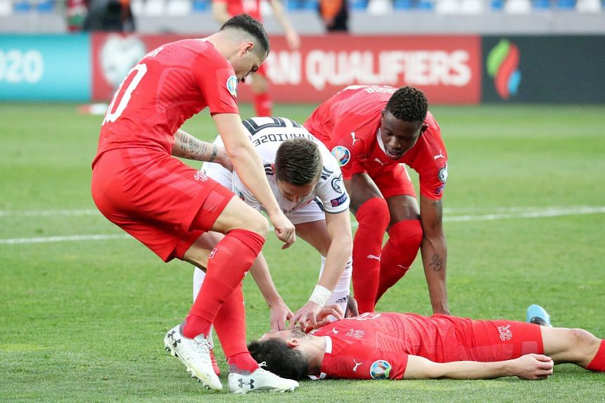 Switzerland's Fabian Schar unconscious after a clash of heads with Jemal Tabidze of Georgia in their Euro 2020 qualifier last Saturday.