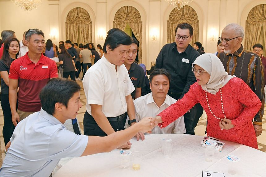 President Halimah Yacob meeting para-swimmer Toh Wei Soong (left) and other Team Singapore athletes, who competed at five major overseas Games, at the Istana yesterday.