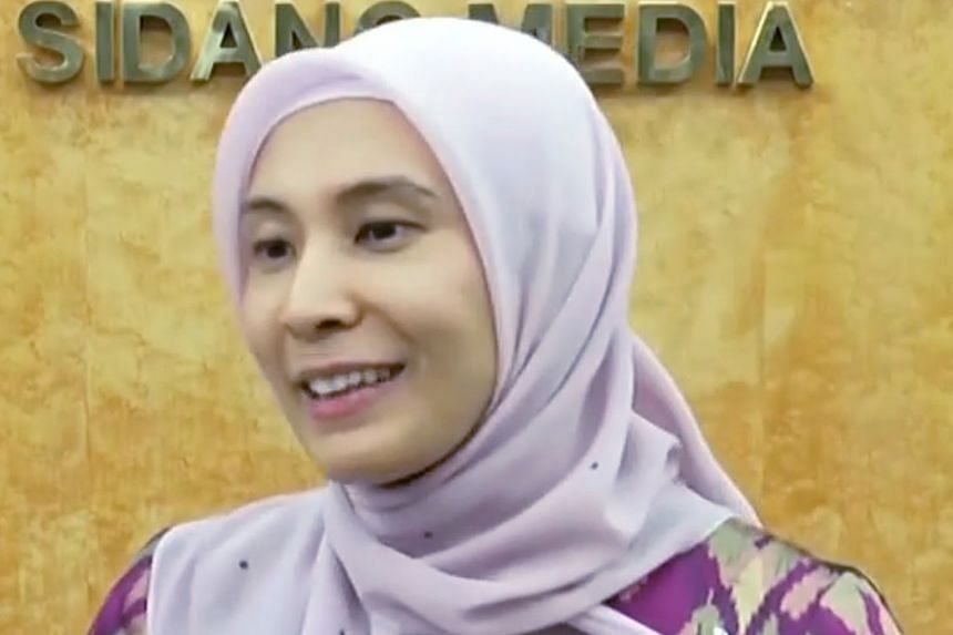 """Malaysian lawmaker Nurul Izzah Anwar speaking at a news conference yesterday. She told reporters that the phrase """"former dictator"""" was factually correct, and repeated her view that reforms were taking place at a """"sluggish pace""""."""