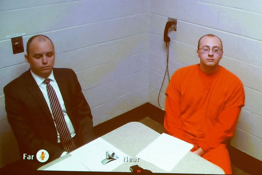 Patterson (right) appears via live video from jail during his first court appearance in Barron, Wisconsin.