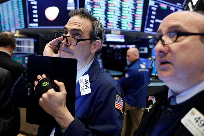 Traders work on the floor of the New York Stock Exchange, March 26, 2019.