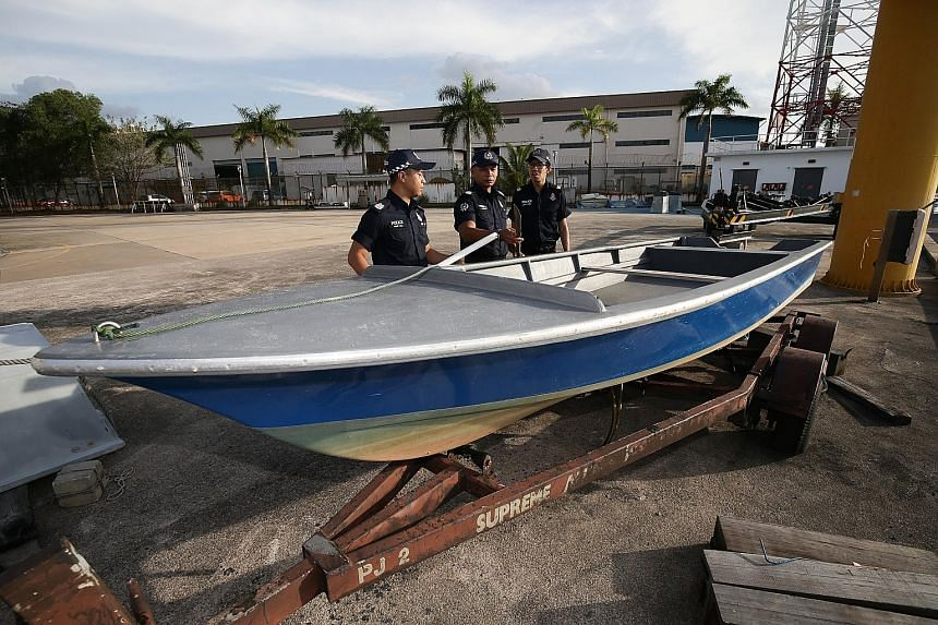 The fibreglass boat that was seized. A Bangladeshi and a Malaysian have been charged with illegal entry into Singapore.