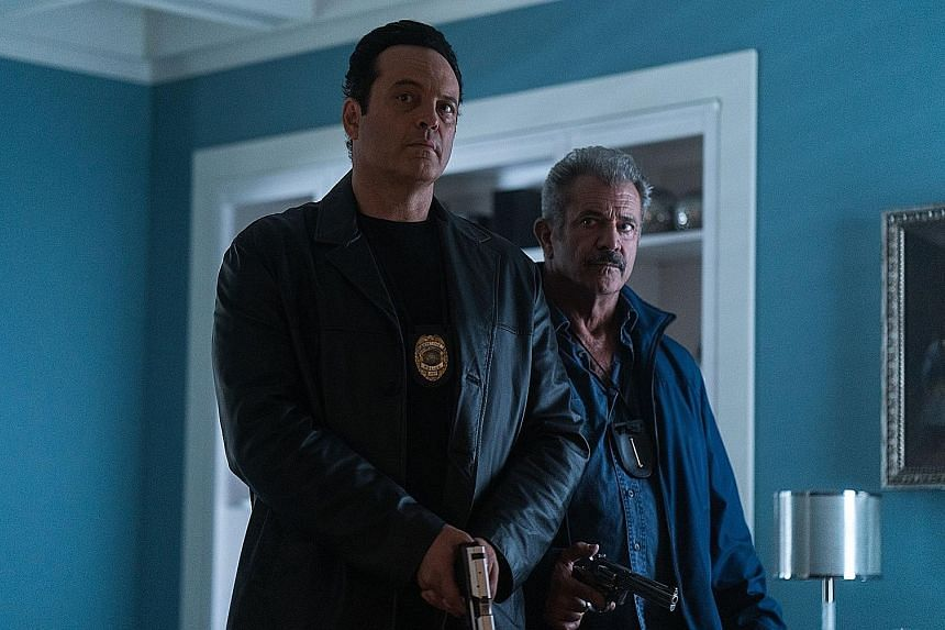 Vince Vaughn (above left) and Mel Gibson play crooked cops who make a mistake on the job.