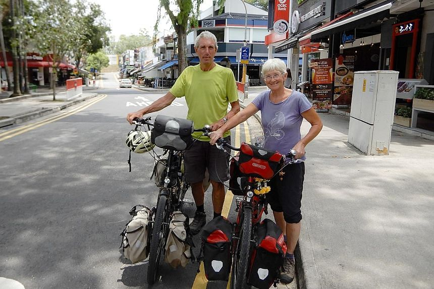 Mr Llyod cycling up a motorway in Athens, Greece. Some parts of the journey can be surreal for him, like cycling on long, empty roads in the Gobi Desert. Mr Paul Llyod and his wife Christine, with their trusty bikes that took them across continents: