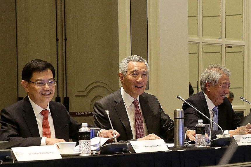 (From left) Finance Minister Heng Swee Keat, Prime Minister Lee Hsien Loong and Deputy Prime Minister Teo Chee Hean at the Research, Innovation and Enterprise Council meeting yesterday, where PM Lee stressed the need to maintain a balance between bas