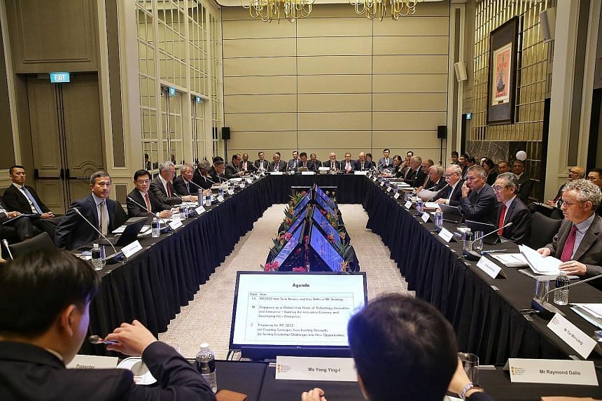 Prime Minister Lee Hsien Loong (middle of left row) chairing the Research, Innovation and Enterprise Council meeting at The St Regis Singapore hotel yesterday. With him were Foreign Minister Vivian Balakrishnan, Finance Minister Heng Swee Keat, Deput