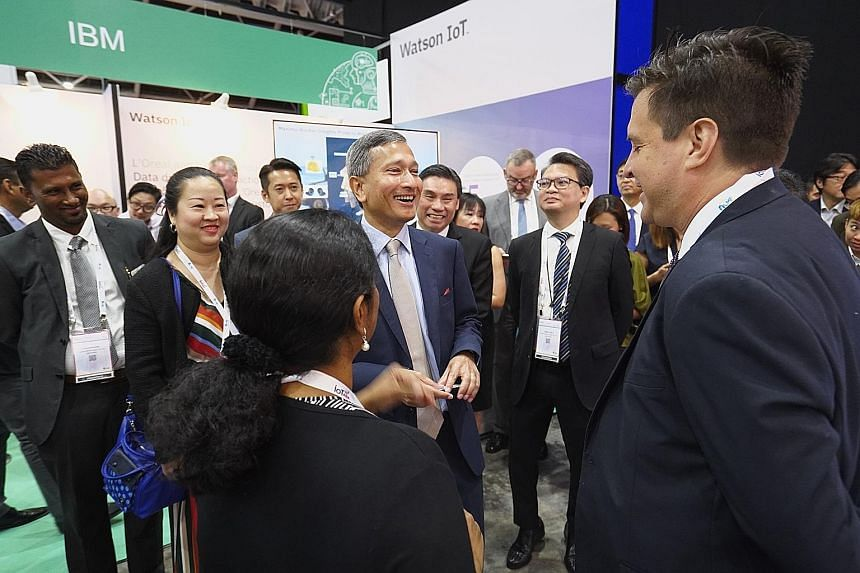 Minister for Foreign Affairs and Minister-in-charge of the Smart Nation initiative Vivian Balakrishnan with delegates at the IoT Asia conference yesterday. In his speech, he underscored the importance of revising legislation in the light of developin