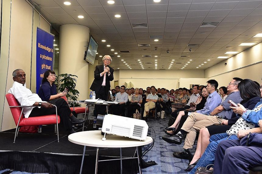 Professor S. Jayakumar and Professor Tommy Koh discussing their new book Pedra Branca: Story Of The Unheard Cases with ST opinion editor Chua Mui Hoong at the National Library yesterday.